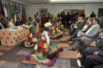 Africa-Nordic Conference held in Cotonou, Benin. Deputy Minister Marius Fransman is on the right looking at the Benin dancers during the Opening Session, 4 June 2012.