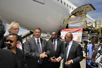 Deputy Minister Marius Fransman hands over humanitarian aid to Madagascar in response to the devastation caused by the recent cyclone Giovanna and tropical storm Irina, Madagascar, 13 March 2012.
