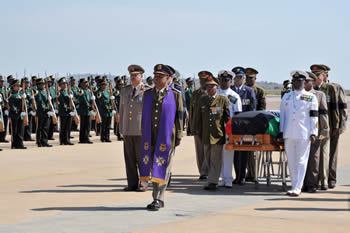 Mortal Remains of President Bingu wa Mutharika of Malawi is returned to Malawi from Pretoria, South Africa, Front: Chaplain General (SANDF) Mr Monwabisi Jamangile just behind Chaplain, Gen Lesley Ford. Bearers to the left: SCWO Clement Mokala, SCWO Raj Narrain, SCWO Dan Tshabalala and SCWO Thando Gogo. Bearers to the right: SCWO Prgasen Moodley, SCWO Moses Sibane and SCWO Fanie Roos, 14 April 2012.