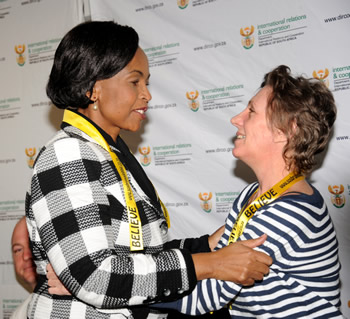 Minister Maite Nkoana-Mashabane and Debbie Calitz embrace at the Press Briefing upon her and Bruno Pelizzari's arrival at the O. R. Tambo International Airport, Johannesburg, South Africa.