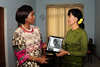 Minister Maite Nkoana-Mashabane presents Mrs Daw Aung San Suu Kyi with a book on Nelson Mandela at the conclusion of their Meeting, Nay Pyi Taw, Myanmar, 4 September 2012.