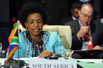 Minister Maite Nkoana-Mashabane addresses the Ministerial Meeting of the Non-Aligned Movement (NAM) Coordinating Bureau (COB). The Head of Official Delegation, Mr Henk van der Westhuisen, is seated behind her, Sherm El Sheik, Egypt, 9-10 May 2012.