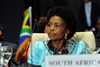 Minister Maite Nkoana-Mashabane is seated behind the flag at the Ministerial Meeting of the Non-Aligned Movement (NAM) Coordinating Bureau (COB).