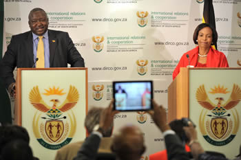 Minister Maite Nkoana-Mashabane with Minister Sam Kutesa of Uganda; during a Press Conference, Pretoria, South Africa, 9 November 2012.