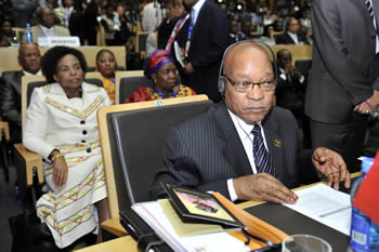 President Jacob Zuma during the opening of the AU Summit. Seated behind him is Minister Maite Nkoana-Mashabane and Minister Nkosazana Dlamini Zuma, 15 July 2012.