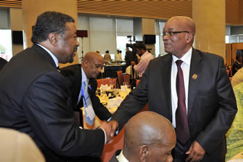 President Jacob Zuma greets AU Chairperson, Mr Jean Ping, at the Lunch of the African Women's Decade Themes and Fundraising to support Fund for African Women's Focus on Agriculture and Food Security, Addis Ababa, Ethiopia, 14 July 2012.