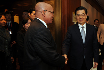 President Jacob Zuma greets President Hu Jintao at the Bilateral Meeting on the sidelines of the Nuclear Security Summit 2012 held in Seoul, South Korea, on 25 March 2012.