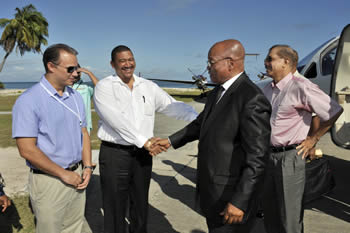 President Jacob Zuma arrives at Desroches Island, Seychelles for the SADC Troika Meeting on Madagascar. With him is President James Michel of Seychelles; Minister of Foreign Affairs Jean-Paul Adam of Seychelles; and Deputy Minister Marius Fransman, 25 July 2012.