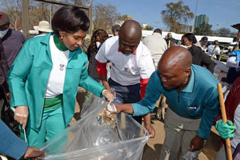 Minister Maite Nkoana-Mashabane and the Diplomatic Corps take part in the clean-up of the City of Tshwane's Bloed Street Taxi Rank for the 67 minutes on Mandela Day, Pretoria, South Africa, 18 July 2014.