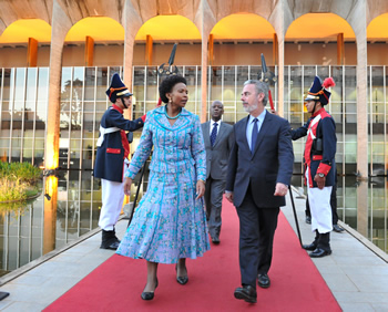 Minister Maite Nkoana-Mashabane is welcomed by her counterpart, Foreign Minister Antonio Patriota of Brazil; as she arrives at the Foreign Ministry in Brasília ahead of their Bilateral Meeting. South African Ambassador to Brazil, Mr Mbete, walks behind them, Brasilia, Brazil, 30 July 2013.