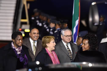 President Michelle Bachelet Jeria of the Republic of Chile arrives in South Africa. She is received by Minister Maite Nkoana-Mashabane and Minister Bathabile Dlamini of the Department of Social Development, Pretoria, South Africa, 8 August 2014.