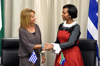 Minister Maite Nkaona-Mashabane and the Greek Ambassador to South Africa, Ms Maria Diamantopoulou, sign an agreement, Pretoria, South Africa, 30 September 2014.