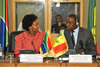 Minister Maite Nkoana-Mashabane and Foreign Minister Mankeur Ndiaye of Senegal, glance at each other as Minister Nkoana-Mashabane delivers her remarks at the Ministerial Meeting in Dakar, Senegal, 30 September 2013.
