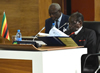 President Robert Mugabe, Chair of SADC, peruse his notes before the opening session of the SADC Double Troika plus Two, Pretoria, South Africa, 15 September 2014.