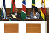 President Jacob Zuma, Chair of the SADC Troika, shares a light moment with Minister Maite Nkoana-Mashabane before the opening session of the SADC Double Troika plus Two, Pretoria, South Africa, 15 September 2014.