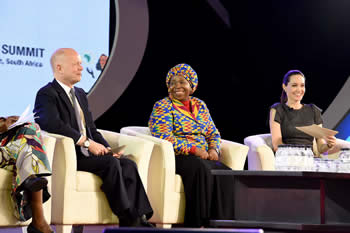 Dr Nkosazana Dlamini Zuma flanked by the Leader of the House of Commons in the UK Parliament, William Hague, and UN Special Envoy for Refugees Issues, Actress Angelina Jolie Pitt, during the High Level Panel on Women, Peace and Security (WPS) held on the margins of the 25th African Union (AU) Summit, Sandton International Convention Centre, Johannesburg, South Africa, 12 June 2015.