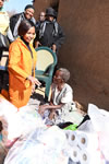 Minister Maite Nkoana-Mashabane meets an elderly lady who was a recipient of a bed, two bunk-beds and bedding from the Chinese Embassy and also some food stuff donated by DIRCO staff during the 67 minutes of Mandela Day, Winterveldt, Pretoria, South Africa, 17 July 2015.