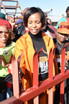 Minister Maite Nkoana-Mashabane paints a fence and plants some seedlings at during the 67 minutes of Mandela Day, Winterveldt, Pretoria, South Africa, 17 July 2015.