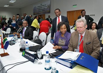 Minister Maite Nkoana-Mashabane with the Minister of Trade and Industry, Mr Rob Davies, at the SADC Council of Ministers Meeting, Harare, Zimbabwe, 6 March 2015.