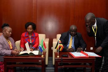 Minister Maite Nkoana-Mashabane and the Foreign Minister of Uganda, H E Oryem Henry Okello; sign a MOU on Language Exchange in a signing ceremony on the margins of the 24th Ordinary Session of the African Union (AU) Assembly, Addis Ababa, Ethiopia, 30 January 2015.