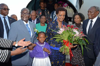 President Robert Mugabe and Mrs Grace Mugabe arrive at the Waterkloof Air Force Base. They are received by Minister Siyabonga Cwele and Minister Maite Nkoana-Mashabane, Pretoria, South Africa, 7 April 2015.