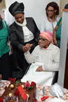 Deputy Minister Nomaindiya Mfeketo hands over a house and celebrates the birthday of Ouma Sara Saas, Rondevlei, Cape Town, South Africa, 8 October 2015.
