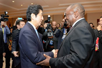 Deputy President Cyril Ramophosa greets Prime Minister Shinzō Abe of Japan on the sidelines of the Asian African Conference Commemoration, Jakarta, Indonesia, 22 April 2015.