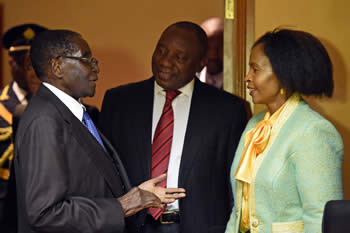 President Robert Mugabe receives a courtesy call from Deputy President Cyril Ramaphoza at the Sheraton Hotel. Deputy President Cyril Ramaphoza is accompanied by Minister Maite Nkoana-Mashabane, Pretoria, South Africa, 8 April 2015.
