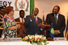 President Mugabe, Chairperson of SADC, hands over the deed and keys for the SADC RPTC to the SADC Executive Secretary, Dr Tax, at the opening session of SADC Extra-Ordinary Summit of Heads of State and Government on Industrialisation, Harare, Zimbabwe, 29 April 2015.