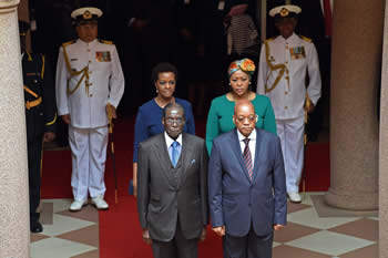 President Jacob Zuma and President Robert Mugabe during the Welcome Ceremony on the occasion of President Mugabe's State Visit to South Africa. They are accompanied by their spouses, Mrs Grace Mugabe and Mrs Thobek Zuma, Pretoria, South Africa, 8 April 2015.