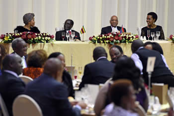 President Jacob Zuma and President Robert Mugabe during the State Banquet at the Sefako Makgatho Presidential Guesthouse. They are accompanied by their spouses, Mrs Grace Mugabe and Mrs Thobeka Zuma, Pretoria, South Africa, 8 April 2015.