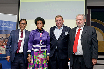 Group photograph: (left to right) Mr Iqbal M Surve from Sekunjalo, Minister Maite Nkoana-Mashabane, the President of Asia – Pacific, Middle East, Africa & Turkey British Telecommunications, Mr Kevin Taylor, and the Minister of Trade and Industry, Mr Rob Davies, Durban, South Africa, 3 May 2017.