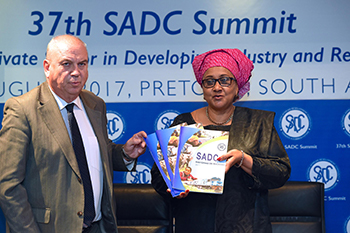 The SADC Executive Secretary, Dr Stergomena Lawrence Tax, and Ambassador Ralf Andreas Breth, from Germany launch the second edition of The SADC Success Stories Book, O R Tambo Building, Pretoria, South Africa, 14 August 2017.